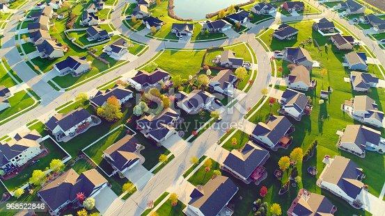 Beautiful, idyllic neighborhoods, homes, Springtime aerial view at sunrise.