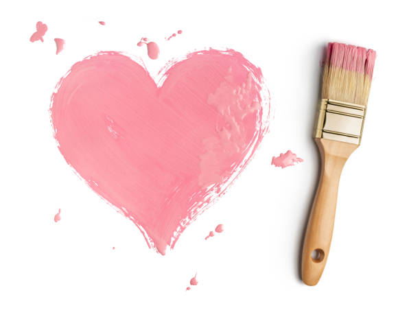 Perfect paintbrush with pink heart on white stock photo