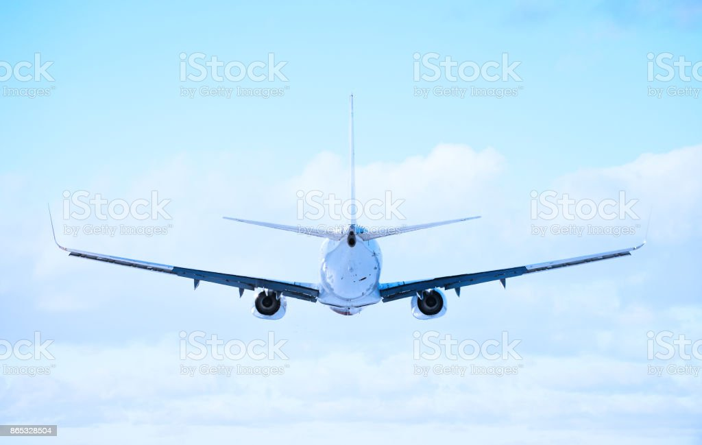 Perfect rear view of commercial airliner mid air stock photo