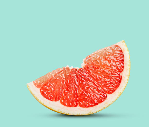 perfect red grapefruit slice on pastel green - agrume foto e immagini stock