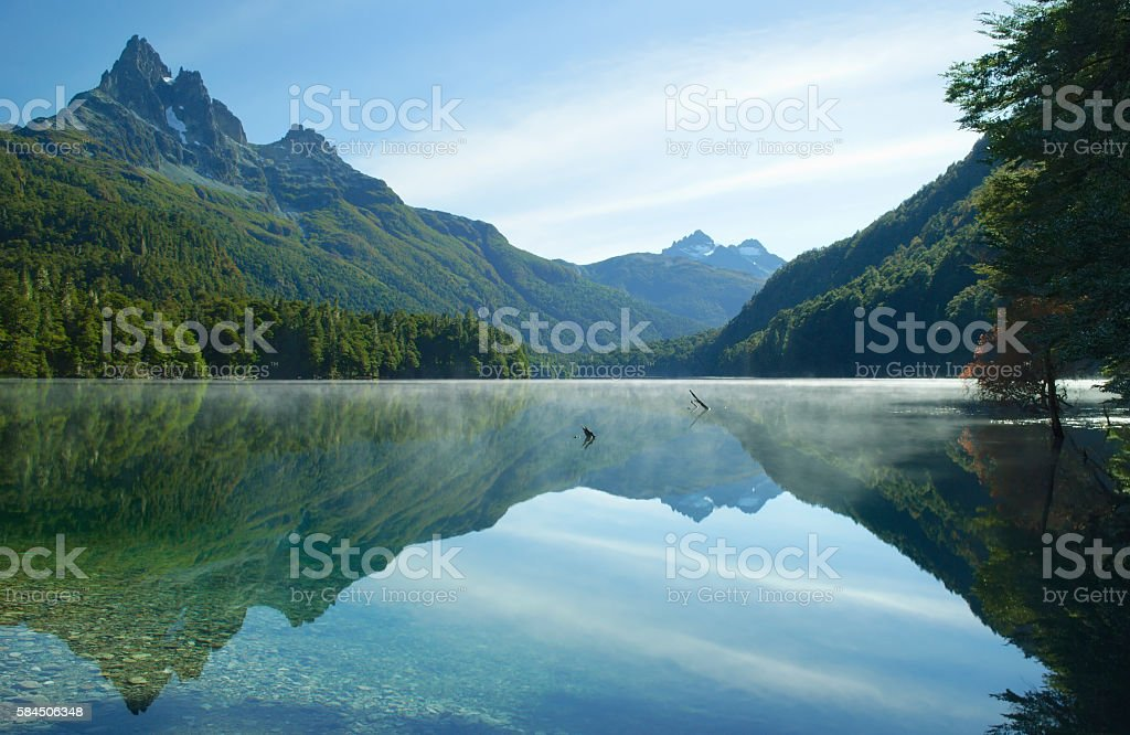 Perfect reflection of the mountains in the clear lake stock photo