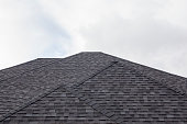A perfect black roof with shingles.