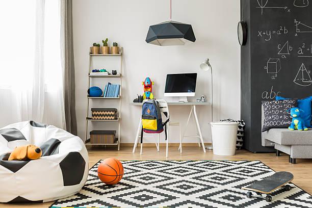 perfect room for a schoolboy idea - fußball themenzimmer stock-fotos und bilder