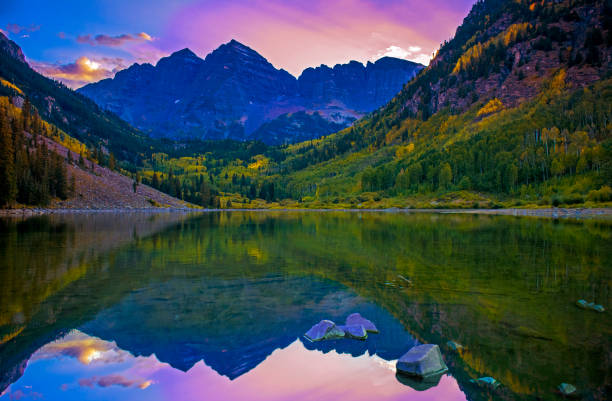 Perfect Scenic View Of Mountains At Sunset Over Lake Reflection stock photo