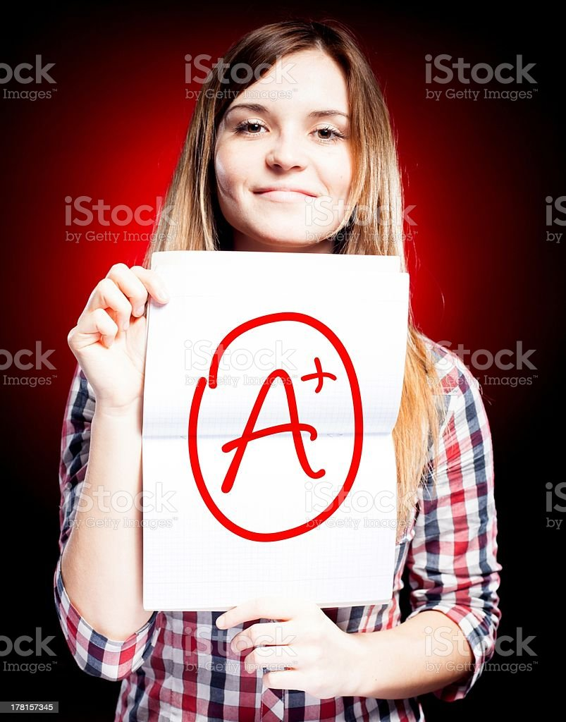 Perfect school grade A plus of exam and happy girl royalty-free stock photo
