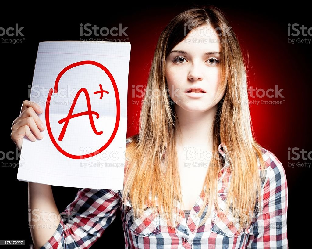 Perfect school grade A plus of exam and proud girl royalty-free stock photo
