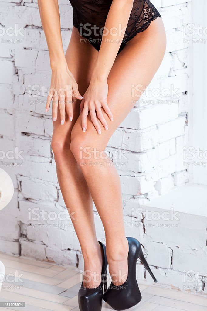 Perfect, sexy legs and ass of young woman wearing seductive - Stock image .
