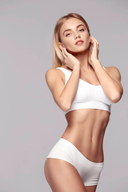Perfect slim toned young body of the girl . stock photo