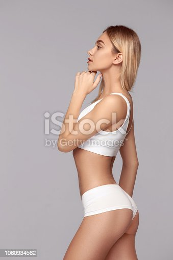 1060934556 istock photo Perfect slim toned young body of the girl . 1060934562