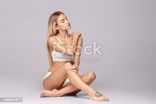 1060934556 istock photo Perfect slim toned young body of the girl . 1068261870