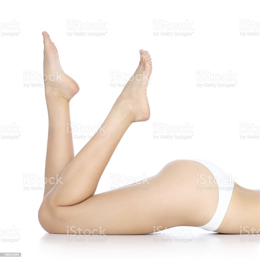 Perfect smooth and waxed woman legs with feet pointing up stock photo
