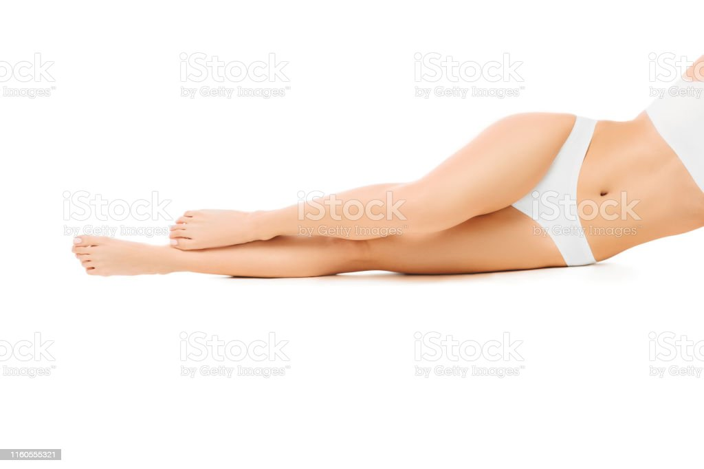 perfect smooth woman's legs without hair after laser epilation. isolated on white background. - Foto stock royalty-free di Adulto