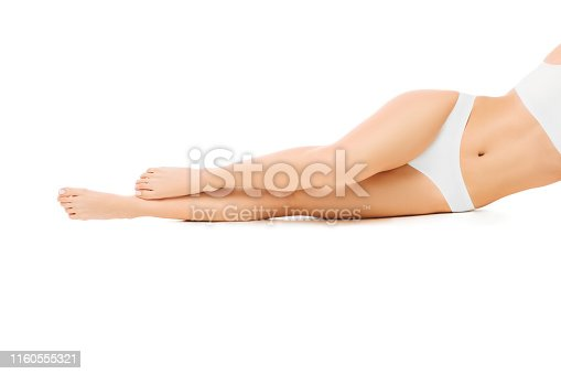 perfect smooth woman's legs without hair after laser epilation. isolated on white background.