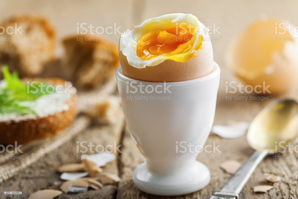 Perfect soft boiled egg for breakfast stock photo
