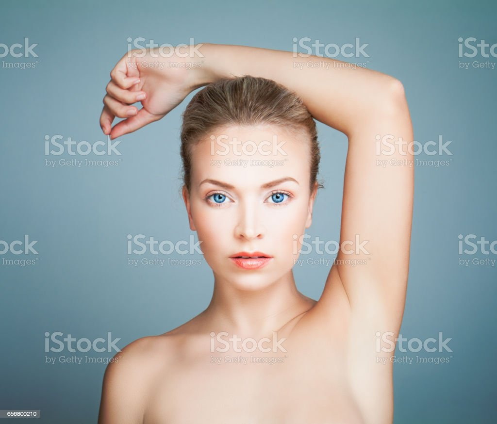 Perfect Spa Model Girl with Healthy Skin on Blue Background. Spa Beauty Portrait stock photo