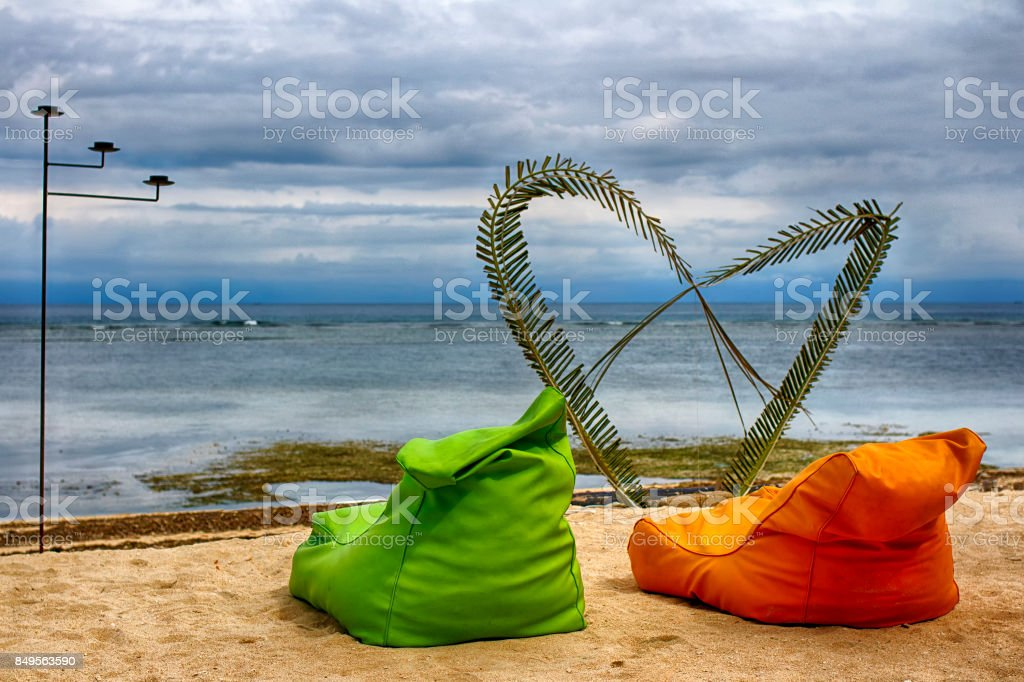 Perfect stay for two in a honeymoon trip. Relax on cushioned loungers during low tide. stock photo