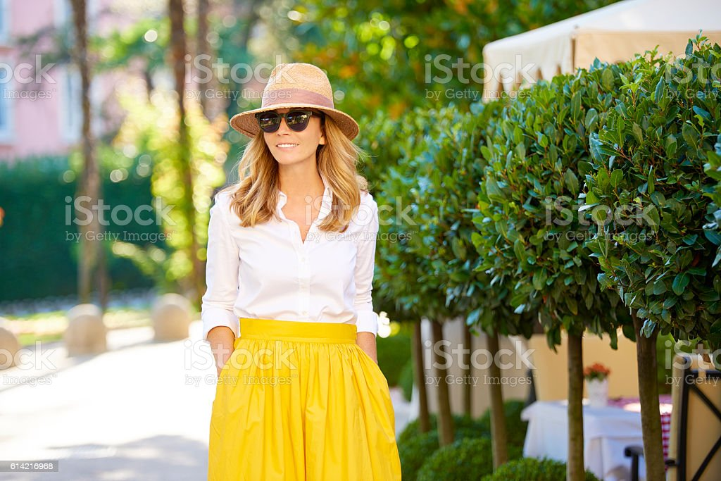 Perfect summer day Shot of a smiling beautiful woman walking on the street and enjoying her life. Adult Stock Photo