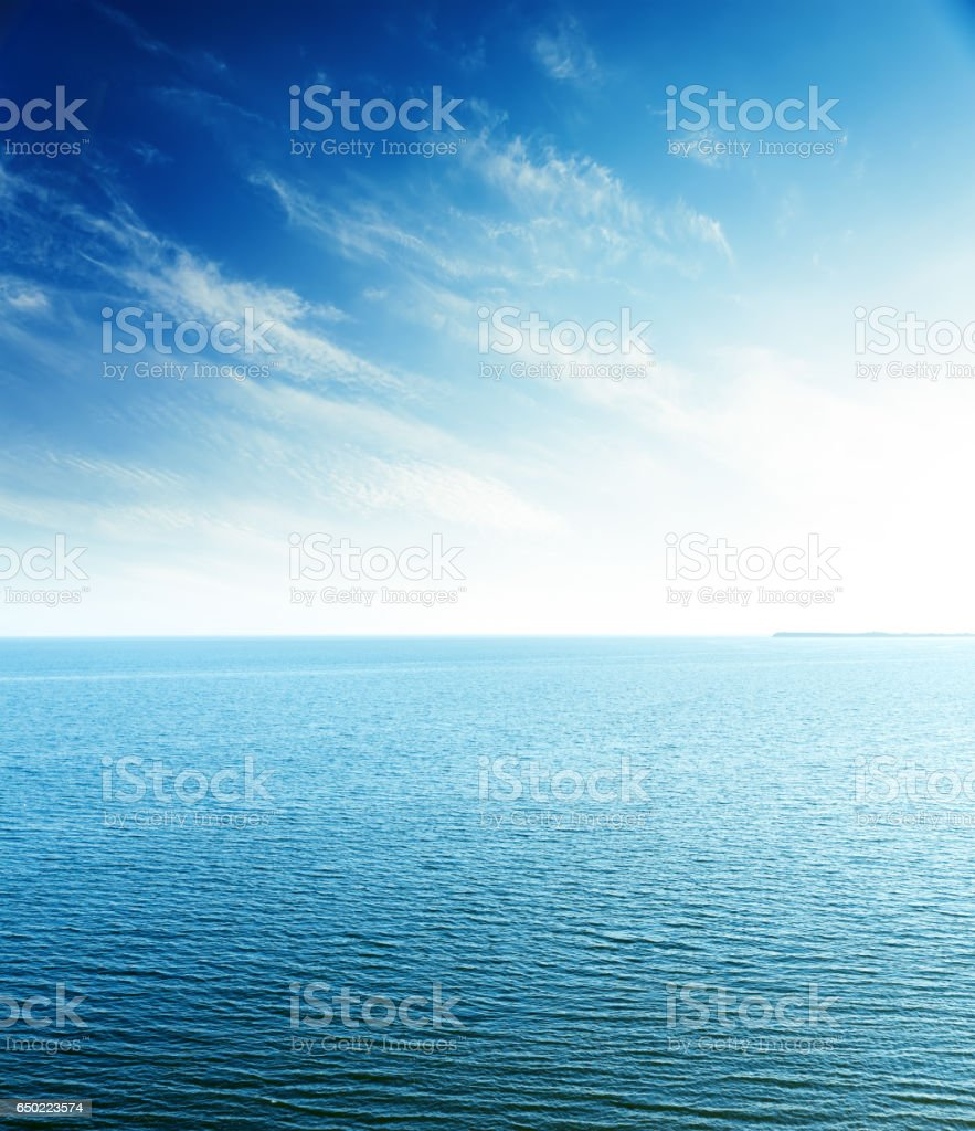 perfect sunset in blue sky over sea. aerial view stock photo