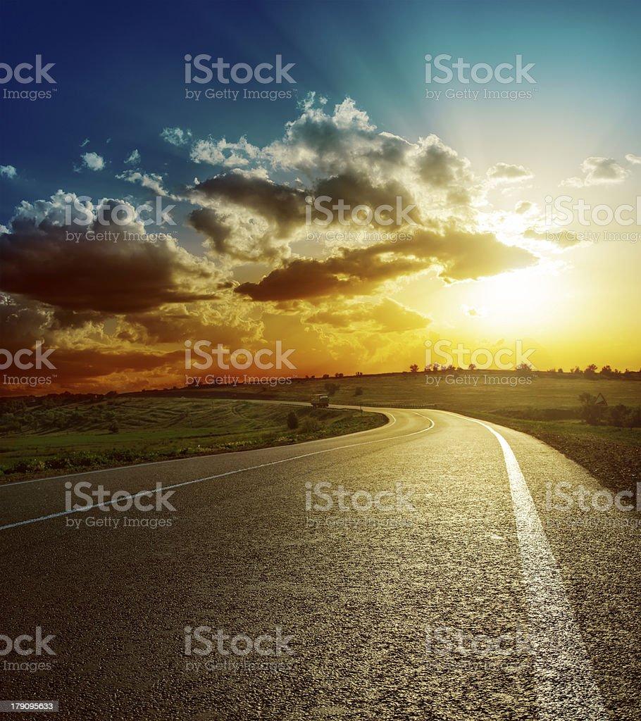 perfect sunset over asphalt road stock photo