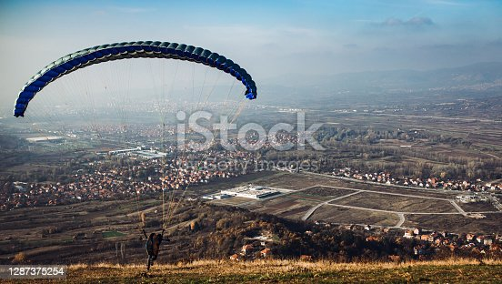 Man starts paragliding