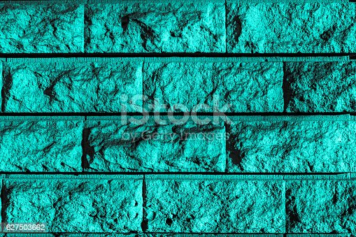 Perfect turquoise grayish grayscale high resolution natural urban Brick wall Background. Close-up of a stylish deco wall backdrop, perfectly designed screen saver. Stone matter surface with mainly horizontal and vertical grid structure.