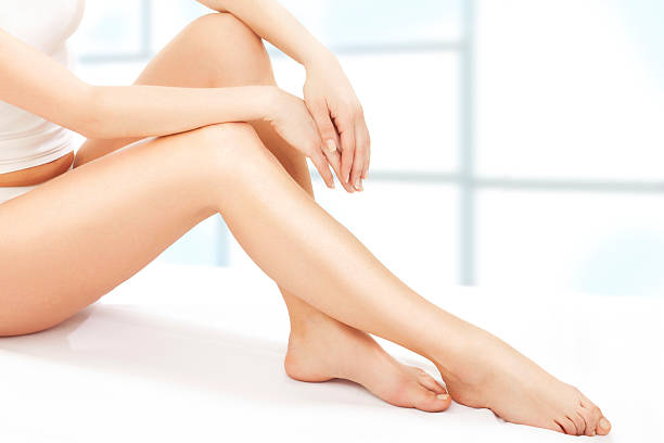 Perfect woman body Slim woman in bed human leg stock pictures, royalty-free photos & images