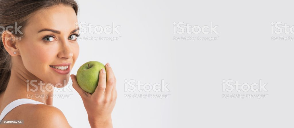 Perfect woman with apple стоковое фото