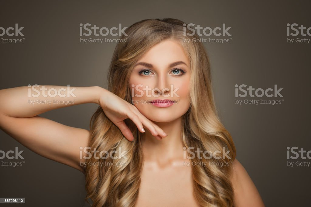Perfect Woman With Blonde Wavy Hairstyle And Natural Makeup On Beige Background Stock Photo