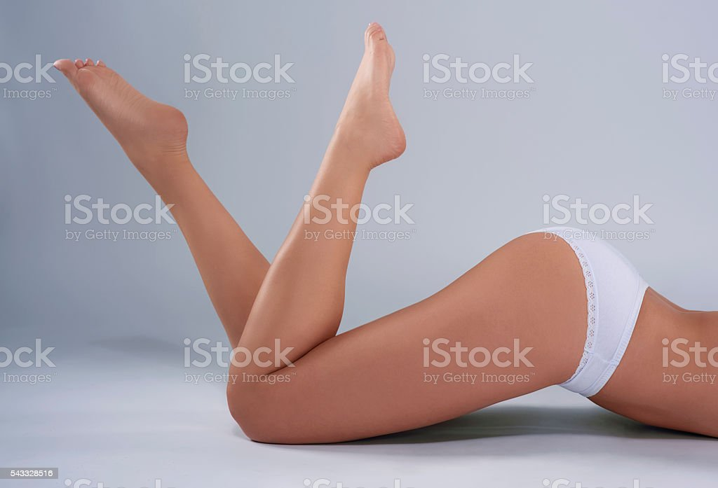 Perfect woman's legs at the studio stock photo