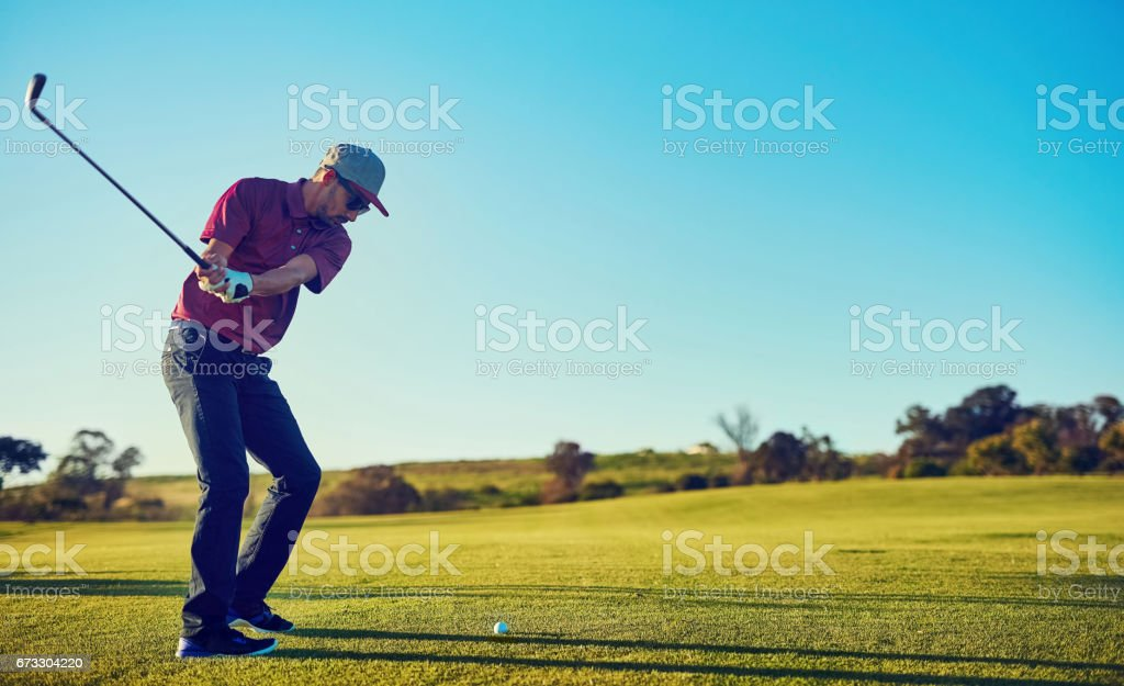 Perfecting his game one swing at a time stock photo