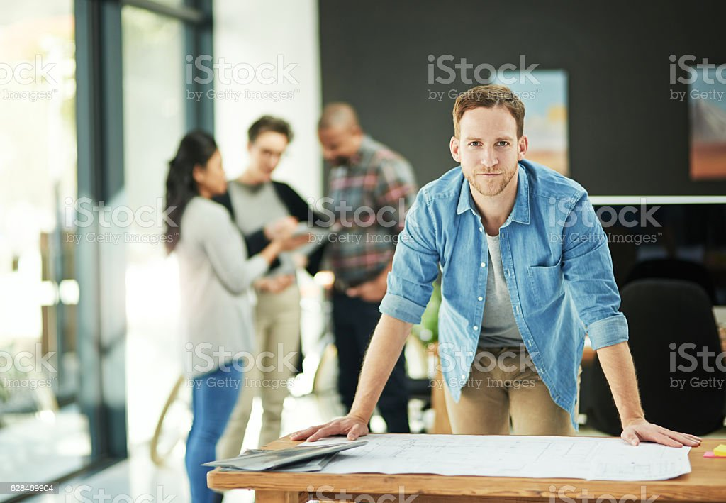 Perfecting his plans to ensure perfect results stock photo