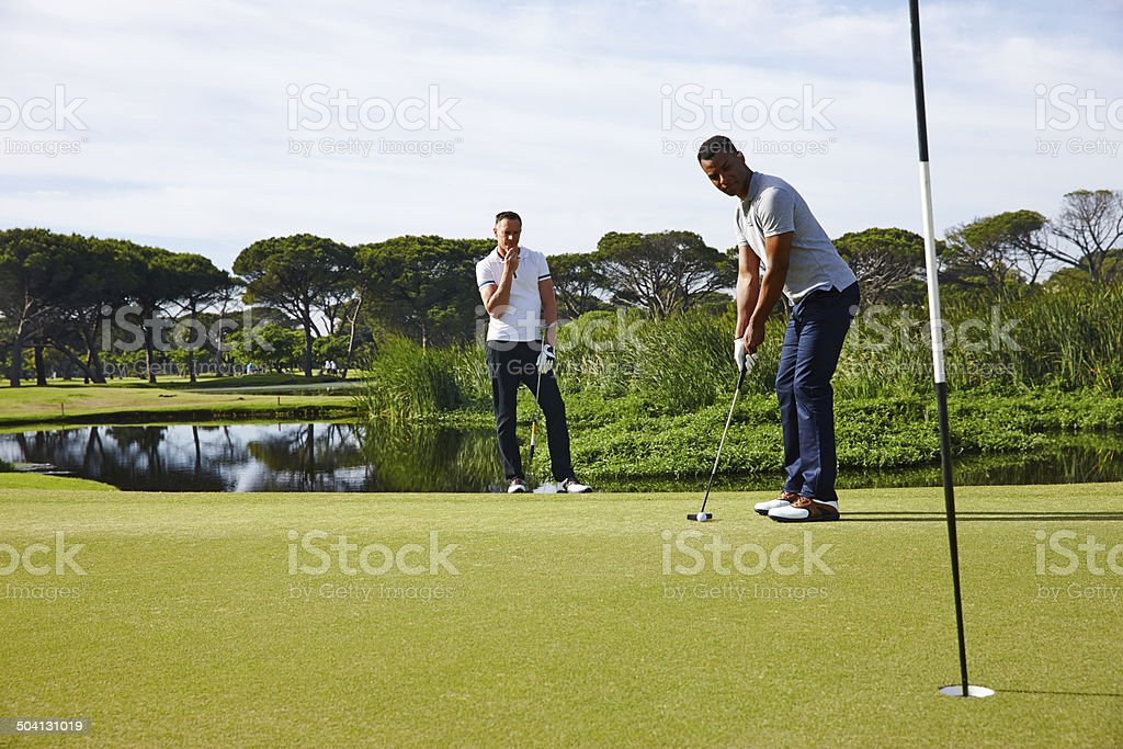 Perfecting his putt royalty-free stock photo