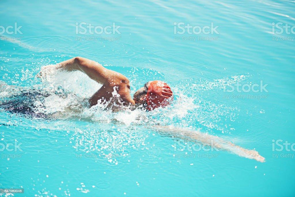 Perfecting his stroke stock photo