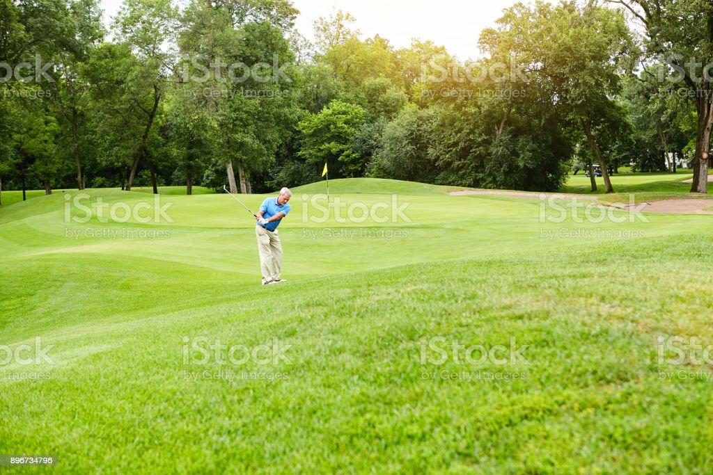 Perfecting his swing stock photo