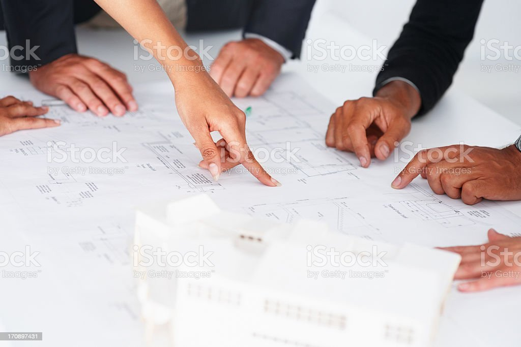 Perfecting the blueprints royalty-free stock photo
