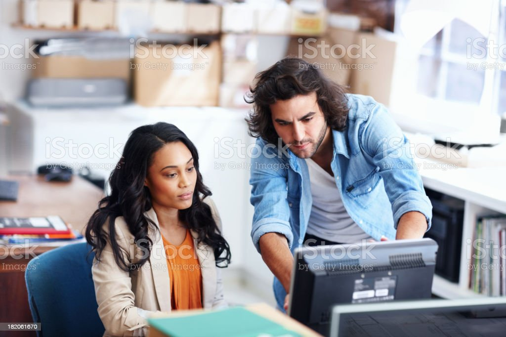 Perfecting their work together - Teamwork royalty-free stock photo