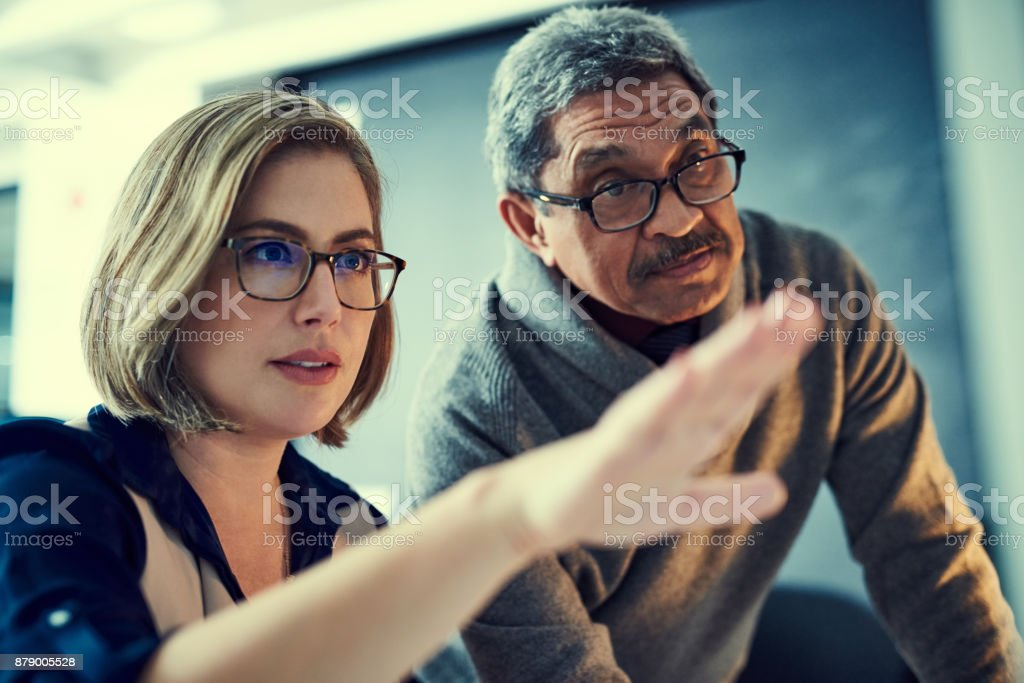 Perfecting their work with some final touches stock photo