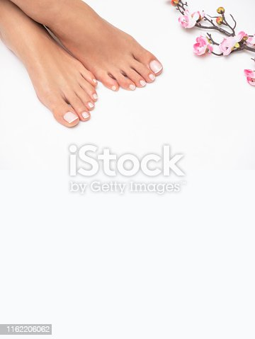 938027870 istock photo Perfectly done french pedicure on white background. 1162206062