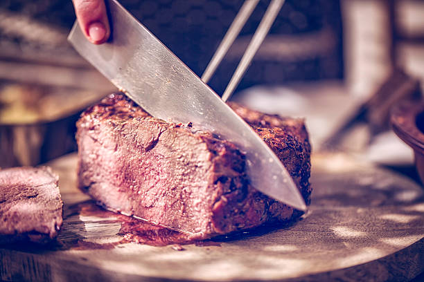 Perfectly Roasted Roast Beef Cut into Slices stock photo