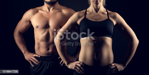 Perfectly shaped female and male upper bodies. Fitness, workout and training concept.