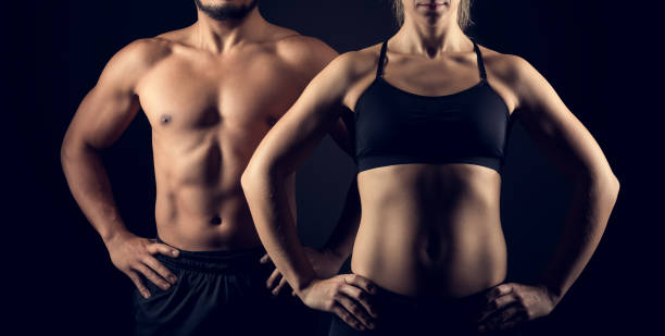 perfectly shaped female and male upper bodies - waist up stock pictures, royalty-free photos & images
