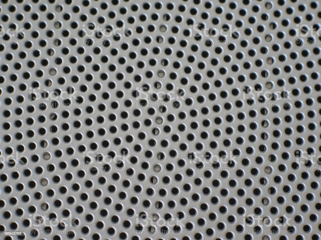 perforated metallic background royalty-free stock photo