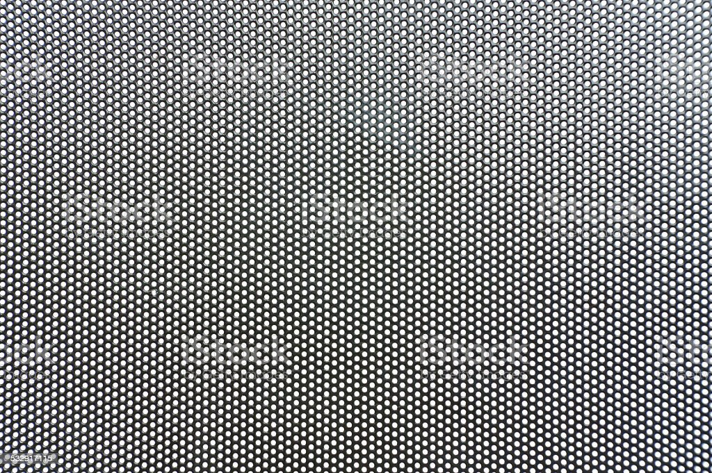 perforated sheet backgrounds stock photo