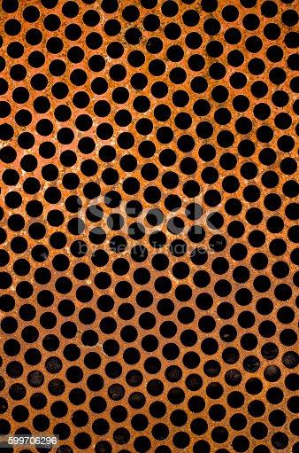 165853308istockphoto perforated steel plate 599706296