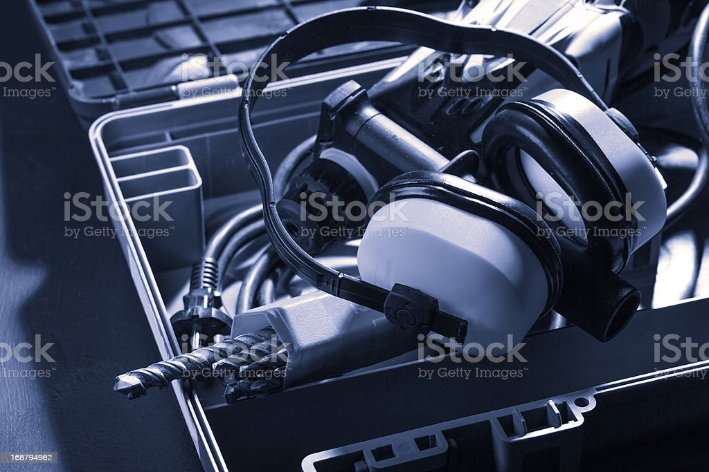 Perforator with boring bits and earphones royalty-free stock photo