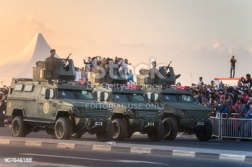 Doha, Qatar - December 18, 2017: Perform of military and civil machines on National Day parade on the Corniche street, Doha, Qatar