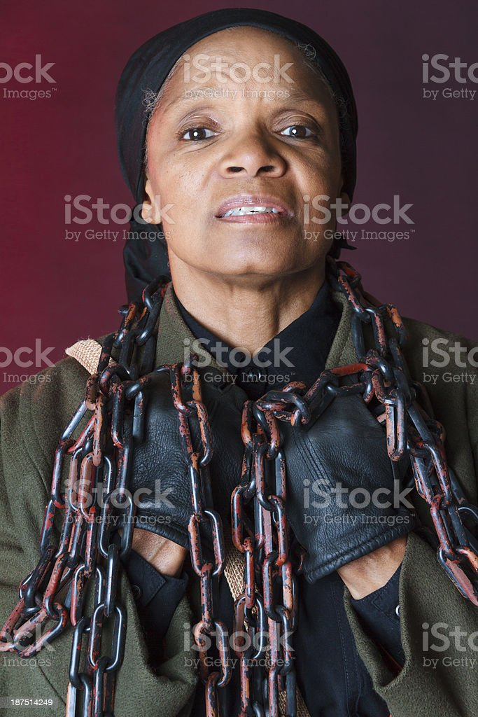 Performance Artist Portraying Harriet Tubman Holding Chains stock photo