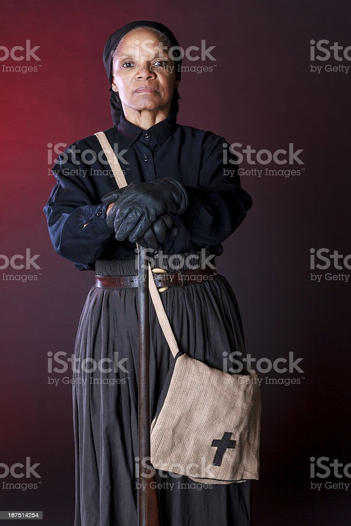 Performance Artist Portraying Harriet Tubman Holding Rifle stock photo