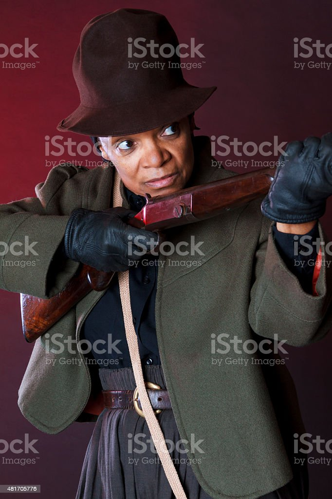 Performance Artist Portraying Harriet Tubman with Rifle stock photo