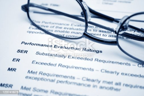 Close up of reading glasses on performance evaluation form